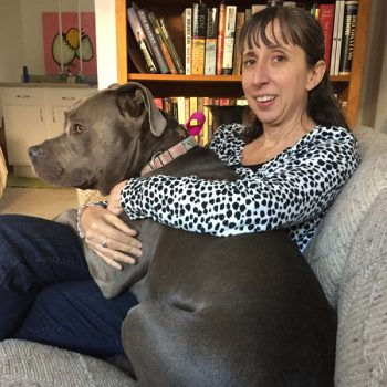Andrea and Jazzy dog on couch